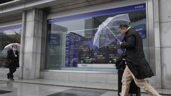 Japan economy shrinks, fueling push for weak yen