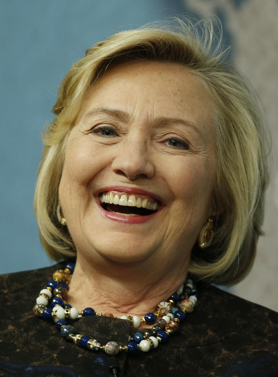 Former U.S. Secretary of State Hillary Clinton laughs as she arrives for an event at Chatham House in London, Friday, Oct. 11, 2013. Clinton is to be presented with the institute's annual award in recognition of her contribution to the significant improvement of international relations, according to the institution. (AP Photo/Lefteris Pitarakis)