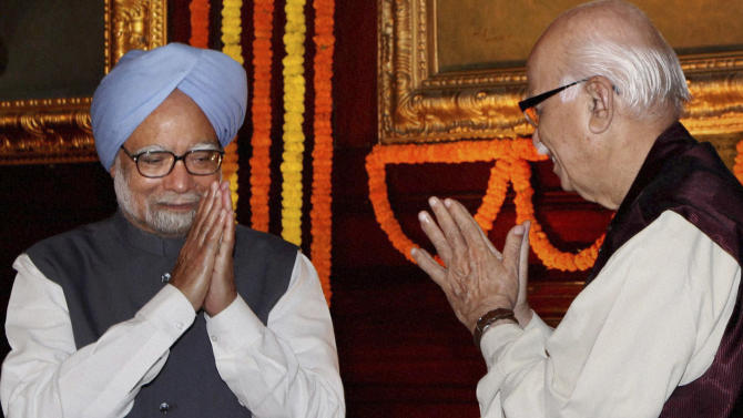 Indian Prime Minister Manmohan Singh, left, and opposition Bharatiya Janata Party's senior leader L.K.Advani greet each other during a function at the Indian parliament in New Delhi, India, Wednesday, March 23, 2011. Singh took to the floor of both houses of Parliament on Wednesday to defend himself and his party from a growing furor over a WikiLeaks cable alleging government corruption.(AP Photo) INDIA OUT