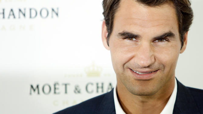 Swiss tennis player Roger Federer poses for photographers during a photocall at the residence of the French ambassador in Madrid in Madrid, Spain on Tuesday, May 5, 2015. (AP Photo/Abraham Caro Marin)