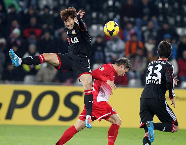 Freiburg's Oliver Sorg and Leverkusen's Son Heung-Min of South Korea, left, challenge for the ball during a round of 16 German soccer cup match between SC Freiburg and Bayer Leverkusen in Frei