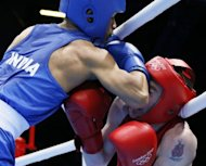 Devendro Singh Laishram of India (in blue) defends against Paddy Barnes of Ireland (in red) during the Light Flyweight boxing quarterfinals of the 2012 London Olympic Games at the ExCel Arena in London. Barnes advanced to the semi-finals with a 23-18 points decision