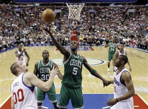 76ers top Celtics 99-86 as Collins gets 400th win