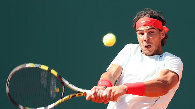 Spain's Rafael Nadal plays a return to Novak Djokovic of Serbia during their final match of the Monte Carlo Tennis Masters tournament in Monaco, Sunday, April 21, 2013. (AP Photo/Claude Paris)