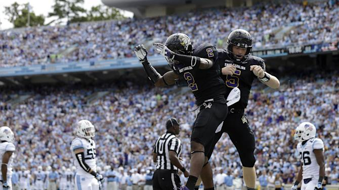 In this Sept. 28, 2013, file photo, East Carolina quarterback Shane Carden (5) and Justin Hardy (2) celebrate Carden's touchdown against North Carolina during the first half of an NCAA college football game in Chapel Hill, N.C. One of the nation's most prolific passing combos faces one final test in the Birmingham Bowl