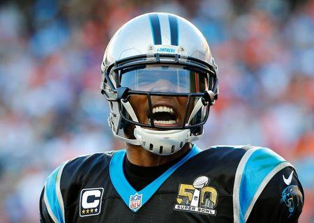 Carolina Panthers' quarterback Cam Newton celebrates a touchdown against the Denver Broncos in the second quarter of the NFL's Super Bowl 50 football game in Santa Clara