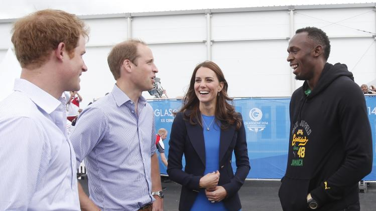 Britain's Prince Harry, Prince William and Catherine, Duchess of Cambridge speak to Jamaica's Usain Bolt during a visit to the Commonwealth Games Village at the 2014 Commonwealth Games in Glasgow