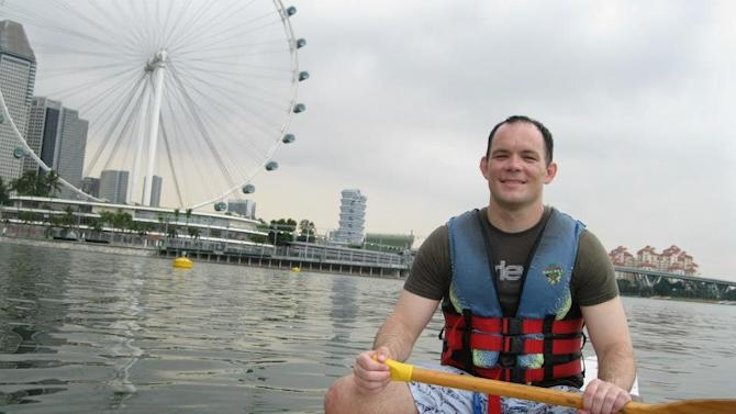 This undated photo released by Rick Todd shows Shane Todd while in Singapore. Months beforeTodd's girlfriend found his body hanging in his Singapore apartment last June, the engineer told his parents he thought his life was threatened and that he was being asked to do something that might hurt U.S. national security. (AP Photo/Courtesy Rick Todd)