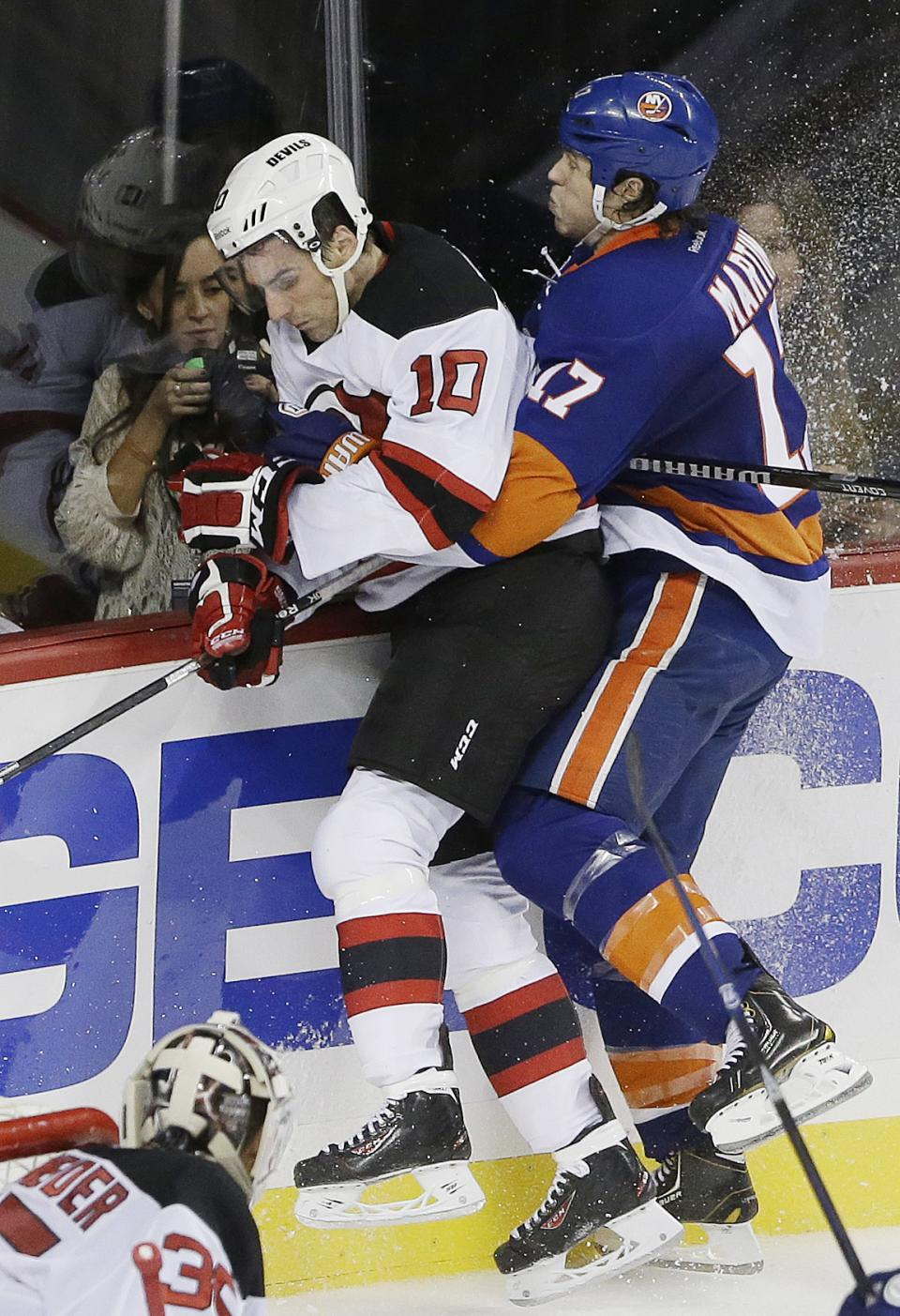 Schneider backstops Devils to 3-0 win over Isles