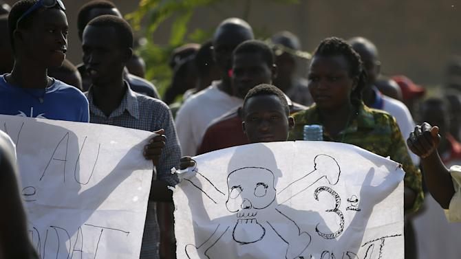 A protester holds a banner during a protest against President Pierre Nkurunziza's decision to run for a third term in Bujumbura