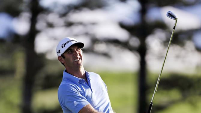 Dustin Johnson tees off on the second hole during the third and final round of the Tournament of Champions golf tournament, Tuesday, Jan. 8, 2013, in Kapalua, Hawaii.  (AP Photo/Elaine Thompson)