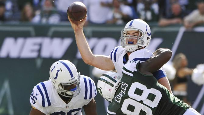 Indianapolis Colts quarterback Andrew Luck is sacked by New York Jets defensive end Quinton Coples (98) while attempting to pass the ball as teammate Mewelde Moore (26) looks on during the second half of an NFL football game Sunday, Oct. 14, 2012 in East Rutherford, N.J. (AP Photo/Bill Kostroun)