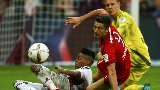 Leverkusen's Wendell tackles Lewandowski of Munich during their German first division Bundesliga soccer match in Munich