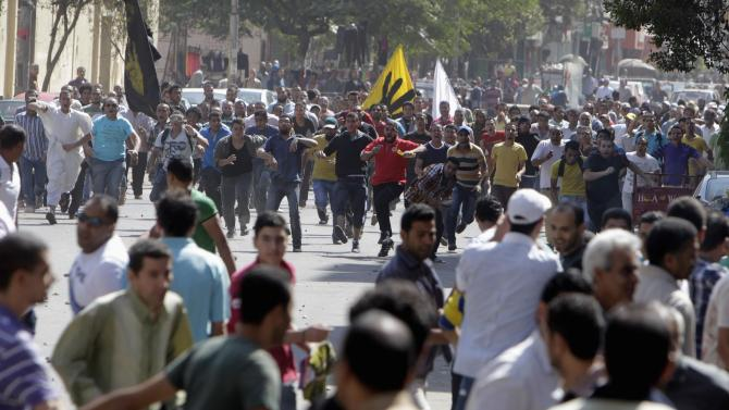 Supporters of deposed President Mursi and Muslim Brotherhood clash with anti-Mursi protesters during march in Cairo