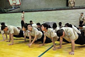 Cadets laugh while doing pushups on October 22, 2013 …