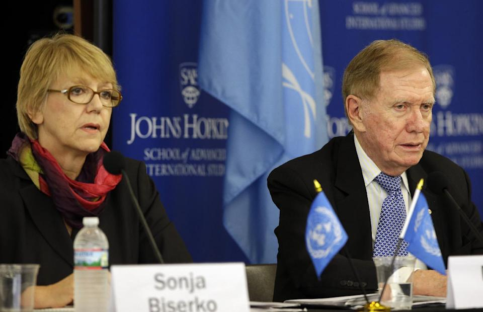 Commission members Sonja Biserko, left, and Michael Kirby, listen during a hearing of the United Nations mandated Commission of Inquiry about the human rights situation in the Democratic People's Republic of Korea, at the Johns Hopkins School of Advanced International Studies, Wednesday, Oct. 30, 2013, in Washington. (AP Photo/Alex Brandon)
