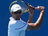 Karlovic serve too much for Dimitrov