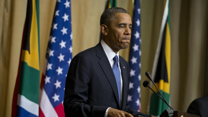 U.S. President Barack Obama pauses during a news conference with South African President Jacob Zuma at the Union Building on Saturday, June 29, 2013, in Pretoria, South Africa. The president is in South Africa, embarking on the second leg of his three-country African journey. The visit comes at a poignant time, with former South African president and anti-apartheid hero Nelson Mandela ailing in a Johannesburg hospital. (AP Photo/Evan Vucci)