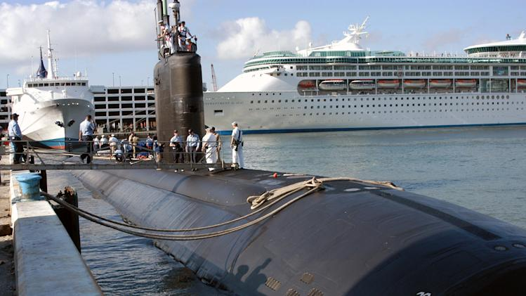 FILE - In this April 26, 2004 file photo provided by the U.S. Navy, the USS Miami (SSN 755) homeported in Groton, Conn., arrives in port in Fort Lauderdale, Fla. The Navy is evaluating whether it's worth spending millions of dollars to repair the nuclear-powered submarine damaged in a fire Wednesday, May 23, 2012 at the Portsmouth Naval Shipyard in Kittery, Maine.  (AP Photo/U.S. Navy, Petty Officer 2nd Class Kevin Langford)