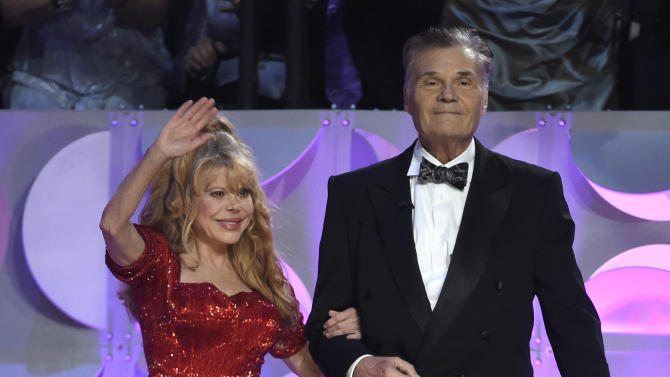 Charo, left, and Fred Willard present the lifetime achievement award at the 42nd annual Daytime Emmy Awards at Warner Bros. Studios on Sunday, April 26, 2015, in Burbank, Calif. (Photo by Chris Pizzello/Invision/AP)