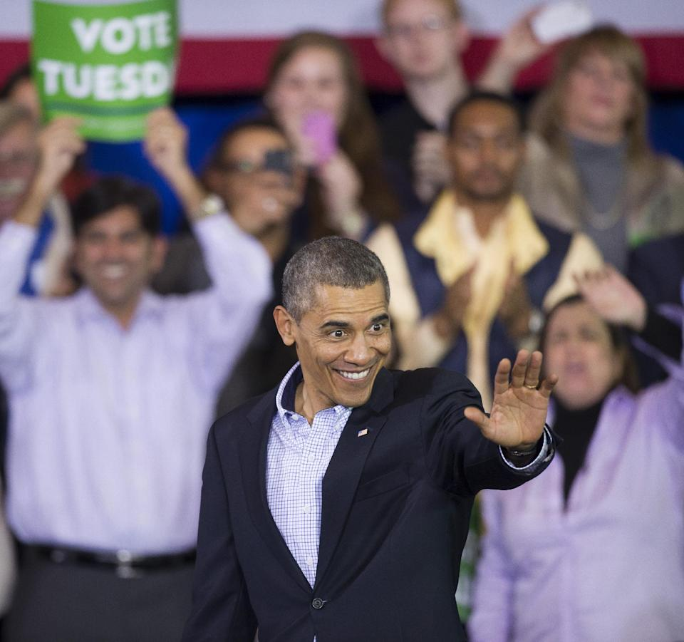 President Barack Obama waves after delivering a speech at a campaign rally with supporters for Virginia Democratic gubernatorial candidate Terry McAuliffe at Washington Lee High School in Arlington, Va., Sunday, Nov. 3, 2013. (AP Photo/Cliff Owen)