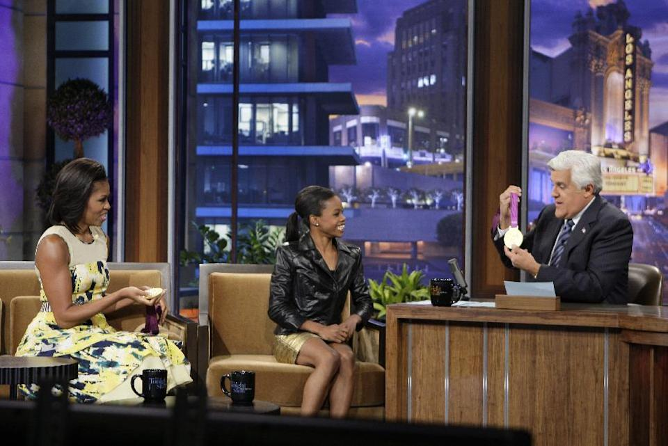 "This Monday, Aug. 13, 2012 photo released by NBC shows first lady Michelle Obama, left, olympic gold medalist Gabby Douglas and host Jay Leno during a taping of ""The Tonight Show with Jay Leno,"" in Burbank, Calif. (AP Photo/NBC, Margaret Norton)"