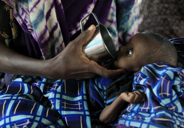 "Jacfar Issack Abdi, 6 months, is fed by his mother as he is treated for malnutrition at a Doctors Without Borders hospital in Dagahaley Camp, outside Dadaab, Kenya, Friday, July 15, 2011. East Africa's drought is battering Somali children, hundreds of whom have been left for dead on the long, dry journey to the world's largest refugee complex in Dadaab, northern Kenya. UNICEF on Thursday called the drought and refugee crisis ""the most severe humanitarian emergency in the world."" (AP Photo/Rebecca Blackwell)"