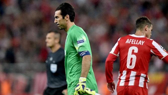 Juventus goalkeeper Gianluigi Buffon trudges off after his team loses 1-0 to Olympiacos in their Group A Champions League clash in Athenson October 22, 2014