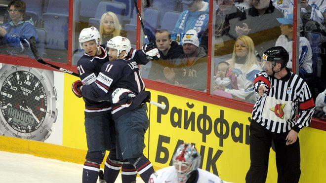 Kyle Okposo Of USA (L) Celebrates AFP/Getty Images
