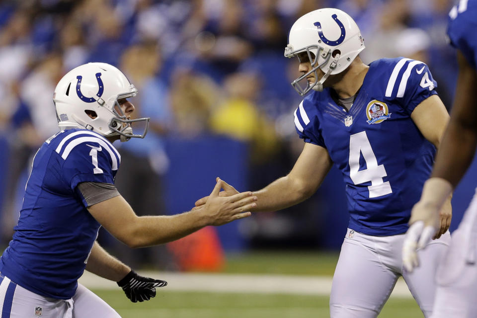 Indianapolis Colts' Adam Vinatieri (4) celebrates with Pat McAfee (1) after Vinatieri kicked a 40-yard field goal during the second half of an NFL football game against the Tennessee Titans, Sunday, Dec. 9, 2012, in Indianapolis. (AP Photo/Jeff Roberson)