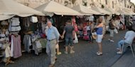<p>Market stalls in Split, Croatia. (Photo courtesy of Don Maker.)</p>