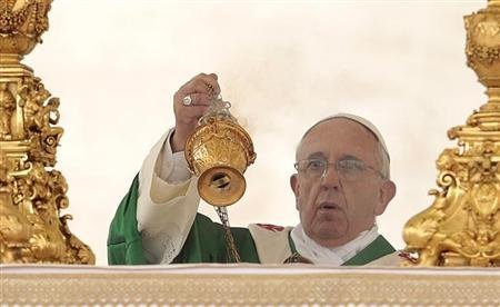 Pope Francis celebrates a mass in Saint Peter's square at the Vatican