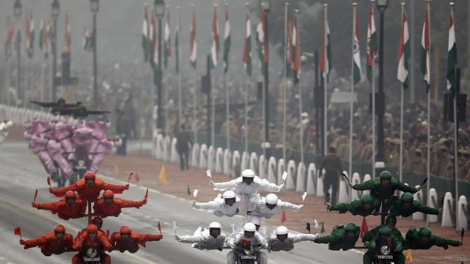 "India's BSF ""Daredevils"" motorcycle riders perform stunts as they take part during the Republic Day parade in New Delhi"