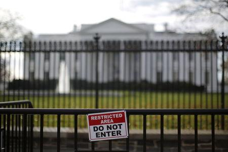 A restricted area sign is seen outside of the White House in Washington