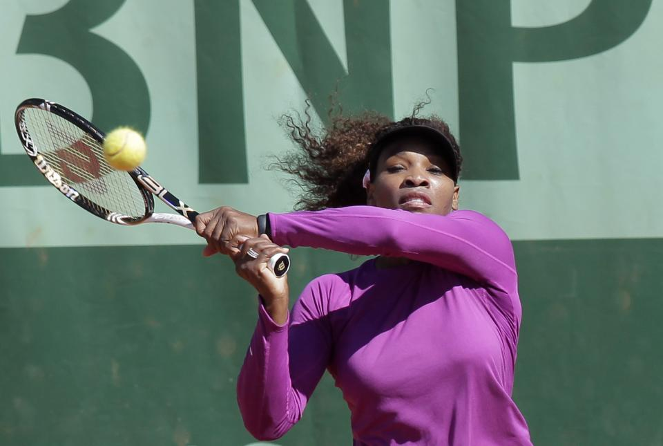 USA's Serena Williams returns the ball as she trains for the French Open tennis tournament at the Roland Garros stadium in Paris, Saturday, May, 26, 2012.  (AP Photo/Michel Euler)
