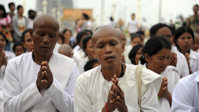 Monks from Takeo province, southwestern Cambodia, pray outside the gate of the Royal Palace in Phnom Penh after the death of former King Norodom Sihanouk, Monday, Oct. 15, 2012. Sihanouk died of a heart attack Monday in Beijing, where he had been receiving medical treatment since January for a variety of ailments. He was 89. (AP Photo)