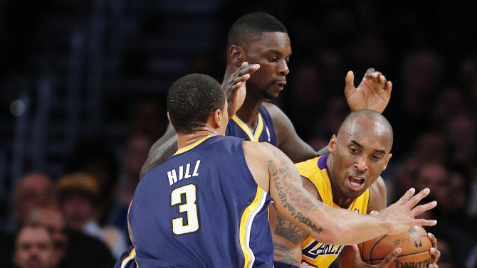 Los Angeles Lakers' Kobe Bryant, right, is defended by Indiana Pacers' George Hill (3) and Lance Stephenson in the first half of an NBA basketball game in Los Angeles, Tuesday, Nov. 27, 2012. (AP Photo/Jae C. Hong)