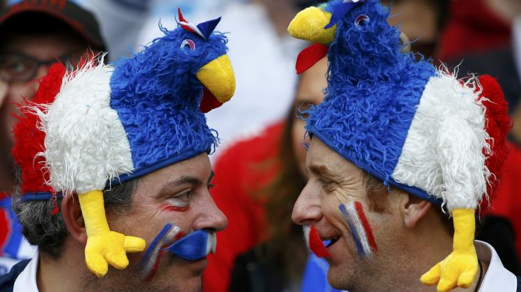 France fans wait for the 2014 World Cup Group E soccer match between France and Honduras at the Beira Rio stadium
