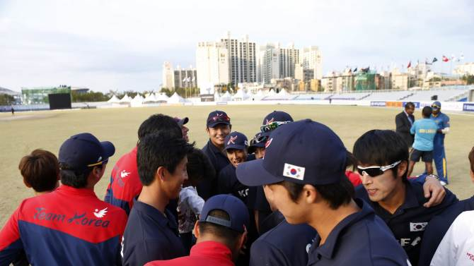 South Korea's cricket team gather after their men's Twenty20 quarter-final cricket match against Sri Lanka at the 17th Asian Games in Incheon