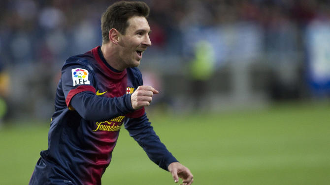 FC Barcelona's Lionel Messi from Argentina celebrates his goal during a Spanish La Liga soccer match against Malaga at the Rosaleda stadium in Malaga, Spain, Sunday, Jan. 13, 2013. (AP Photo/Julian Rojas Ocana)