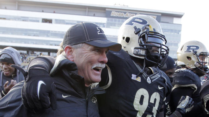 Purdue head coach Danny Hope, left, celebrates with defensive tackle Kawann Short after Purdue defeated Indiana 56-35 in an NCAA college football game in West Lafayette, Ind., Saturday, Nov. 24, 2012.  (AP Photo/Michael Conroy)
