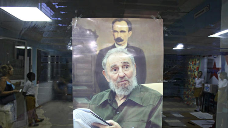 A picture of Cuba's leader Fidel Castro is seen at a polling station in Havana Sunday Oct. 21, 2012. Cubans are going to the polls Sunday to vote in municipal elections. A top executive of the Hotel Nacional told the AP Sunday 86-year-old Fidel Castro appeared in public for the first time in months at the hotel Saturday challenging persistent rumors that the aging revolutionary is near death.(AP Photo/Ismael Francisco/Cubadebate)
