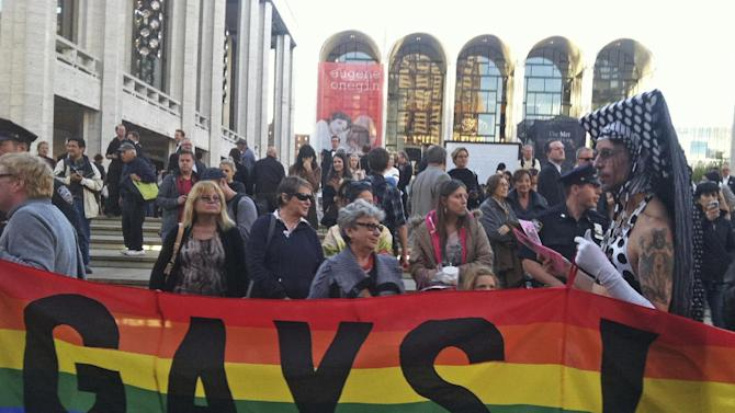 In this photo provided by Queer Nation NY, anti-Putin protestors demonstrate in front of the Metropolitan Opera at Lincoln Center, Monday, Sept. 23, 2013, in New York, where the Met held it's season-opening gala featuring soprano Anna Netrebko and conductor Valery Gergiev, two longtime supporters of Russian President Vladimir Putin. Putin, who has upheld anti-gay laws passed by the Russian legislature, has denied that homosexuals face discrimination in Russia and said the law does not infringe on their rights. (AP Photo/Scott Wooledge, Queer Nation NY)
