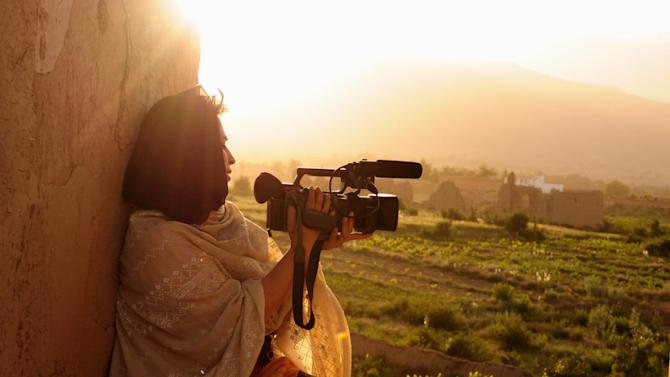 """Samar Minallah Khan's films focus primarily on the practice of swara, where a daughter is given away as compensation for a crime. Swara happens mainly in poor, rural areas. An anthropologist and documentarian who grew up in Pakistan but was educated in England, she started investigating swara in the early 2000s. The more she learned, the more upset she became. In 2003, her documentary   Swara —   A Bridge Over Troubled Water , profiled victims and their families. Khan went into rural regions and spoke with men who had been forced to give a daughter or sister away as compensation for a crime or to settle a family feud. Her work challenged the norms in very traditional areas of Pakistan; she faced intimidation and death threats. And she still does. Most of the initial footage for her most recent documentary on swara was unusable because the cameraman was shaking from fear. Those challenges have led Khan to find an unlikely protagonist for her documentaries. Over and over, she was impressed by the men who opposed this practice. """"Men, too, face hurdles for speaking up and for challenging norms,"""" she says. """"Standing up in the face of society and country expectations, that takes a lot of courage.""""   Filmmaker Wants To Stop Fathers From Giving Up Their Daughters   Photo: Courtesy of Samar Minallah Khan"""
