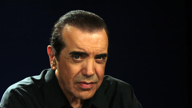 "This Aug. 27, 2012 photo shows actor Chazz Palminteri posing during an interview in New York. Palminteri is taking to the airwaves with ""Ask Chazz,"" a four-week series of live, call-in shows on SiriusXM Radio, where callers can seek advice on a variety of topics including the entertainment business and relationships. (AP Photo/John Carucci)"