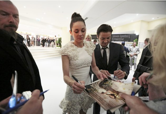 "Cast members Marion Cotillard and Jeremy Renner sign autographs after a news conference for the film ""The Immigrant"" during the 66th Cannes Film Festival"