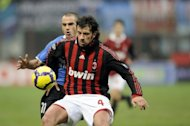 This file photo shows then AC Milan's Georgian defender Kakha Kaladze (R) fighting for the ball with Novara's Pablo Andres Gonzalez a Coppa Italia match in Milan, in 2010