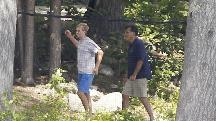 Republican presidential candidate, former Massachusetts Gov. Mitt Romney stands with his son Ben Romney as they play volleyball at their vacation home on Lake Winnipesaukee in Wolfeboro, N.H., Tuesday, July 3, 2012. (AP Photo/Charles Dharapak)