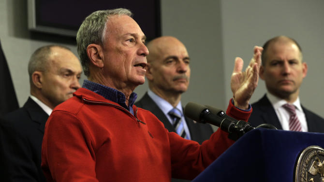 New York Mayor Michael Bloomberg, foreground, briefs the media about the pending snow storm, at New York City's Office of Emergency Management,  Friday, Feb. 8, 2013. He is accompanied by Police Commissioner Ray Kelly, left, Fire Commissioner Salvatore Cassano, second from right, and Deputy Mayor for Operations Cas Holloway. Snow began to fall as a massive blizzard headed for the American Northeast on Friday, sending residents scurrying to stock up on food and supplies ahead of a storm poised to dump up to 3 feet of  snow from New York City to Boston and beyond.(AP Photo/Richard Drew)