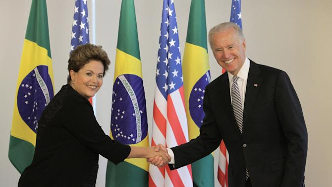 U.S. Vice President Joe Biden, right, shakes hands with Brazil's President Dilma Rousseff during a photo opportunity at the Planalto presidential palace in Brasilia, Friday, May 31, 2013. (AP Photo/Eraldo Peres)
